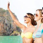 happy young women in bikinis on bali beach